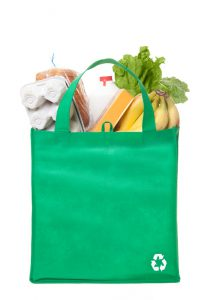A reusable grocery bag with recycle symbol